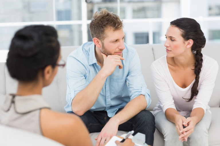 Unhappy couple at therapy session